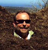 Tim in a pile of compost